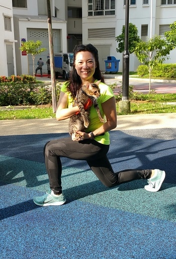 walking lunge workout outdoor exercise carrying cute cat